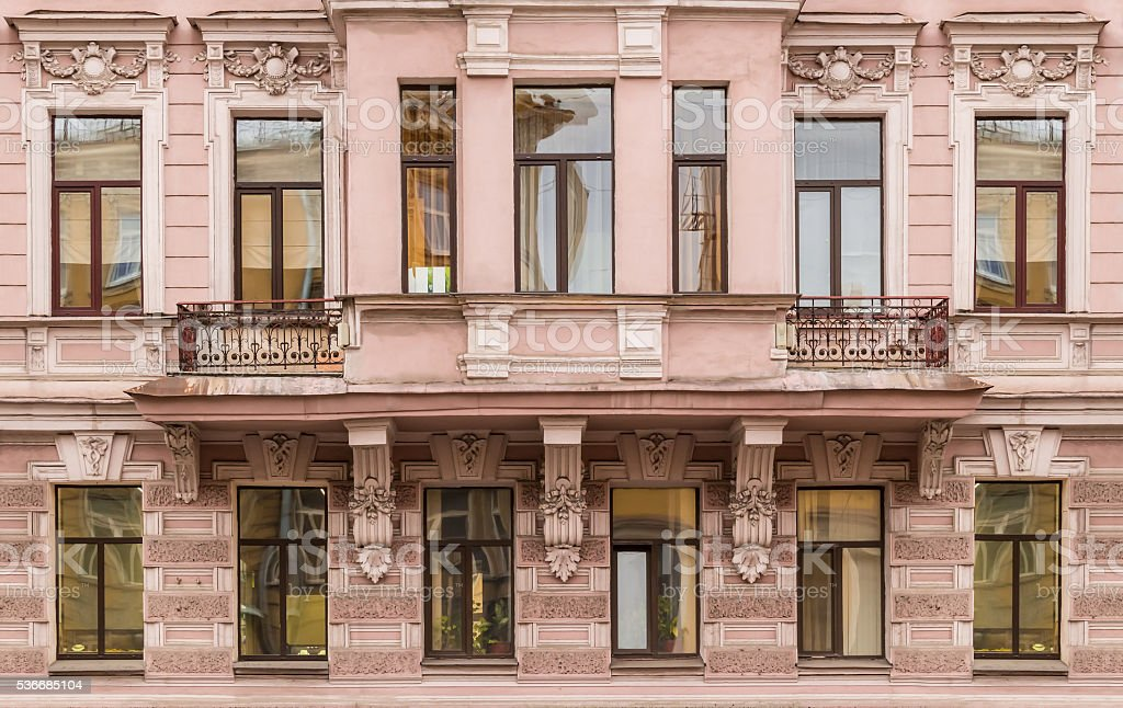 Windows in a row and bay window on facade stock photo