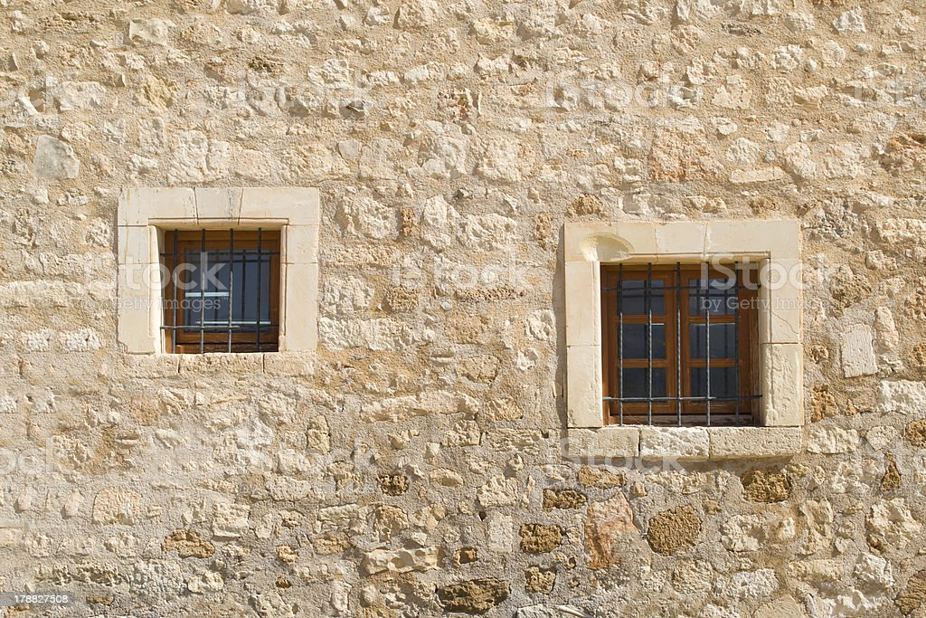 Windows in stone wall. royalty-free stock photo