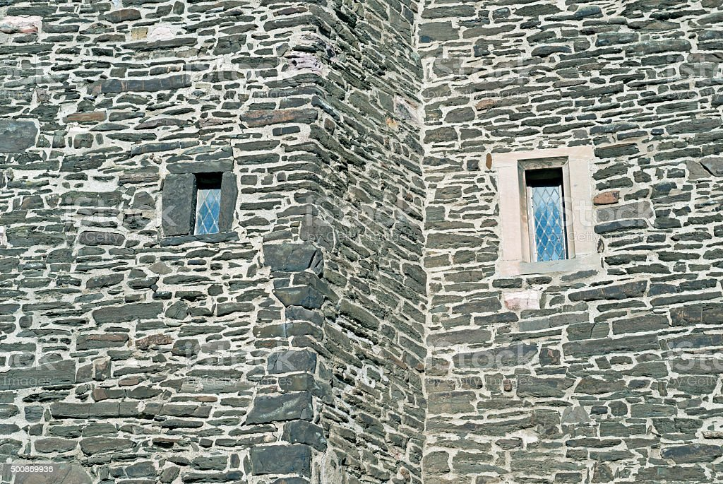 Windows in wall of church at Conwy Wales stock photo