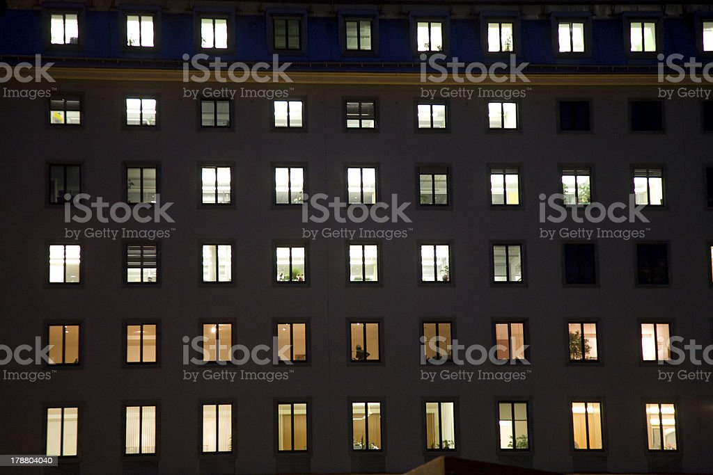 windows of a business house with light by night royalty-free stock photo