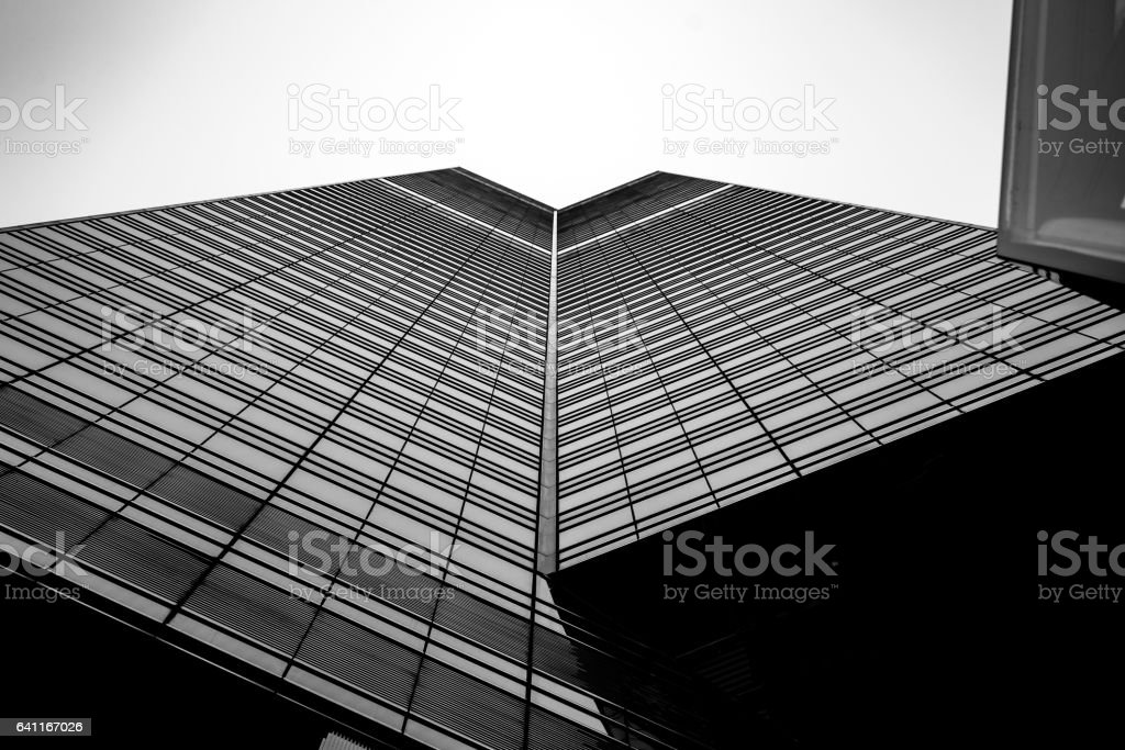 Windows of  commercial building in Hong Kong with B&W color stock photo