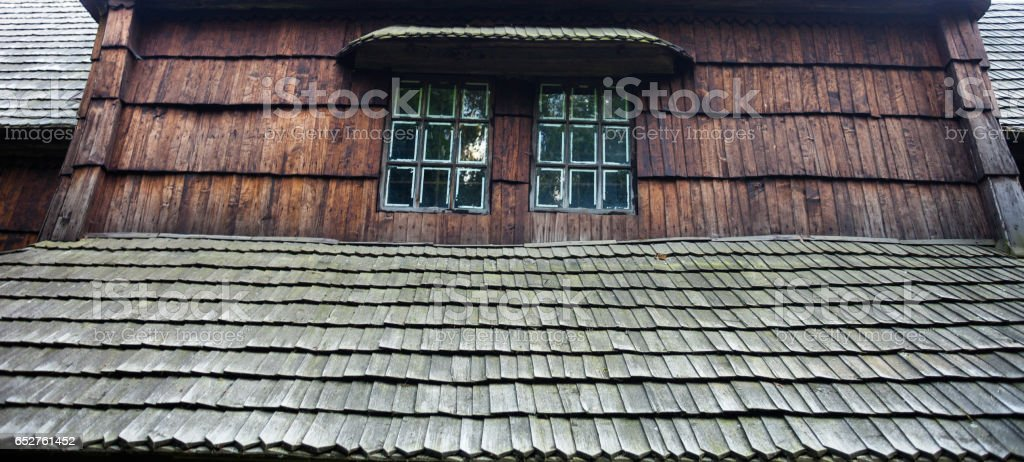Windows of the ancient wooden church stock photo