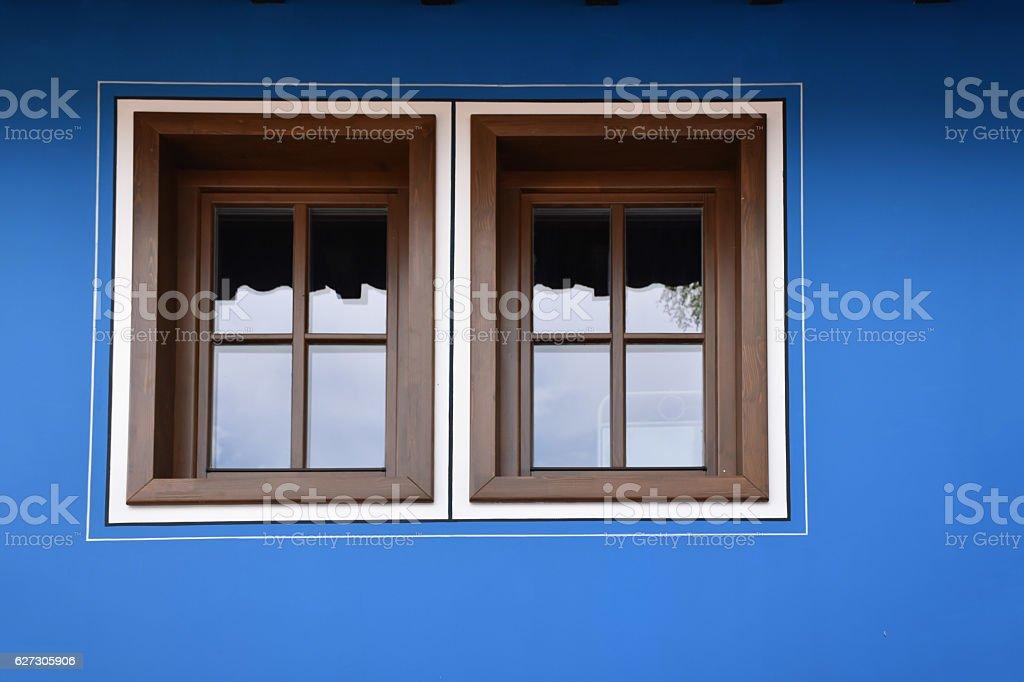 Windows on a blue facade stock photo