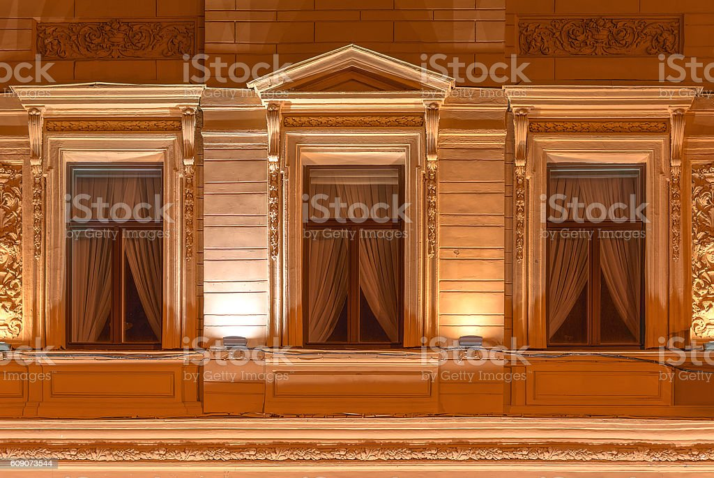 Windows on night facade of office building stock photo