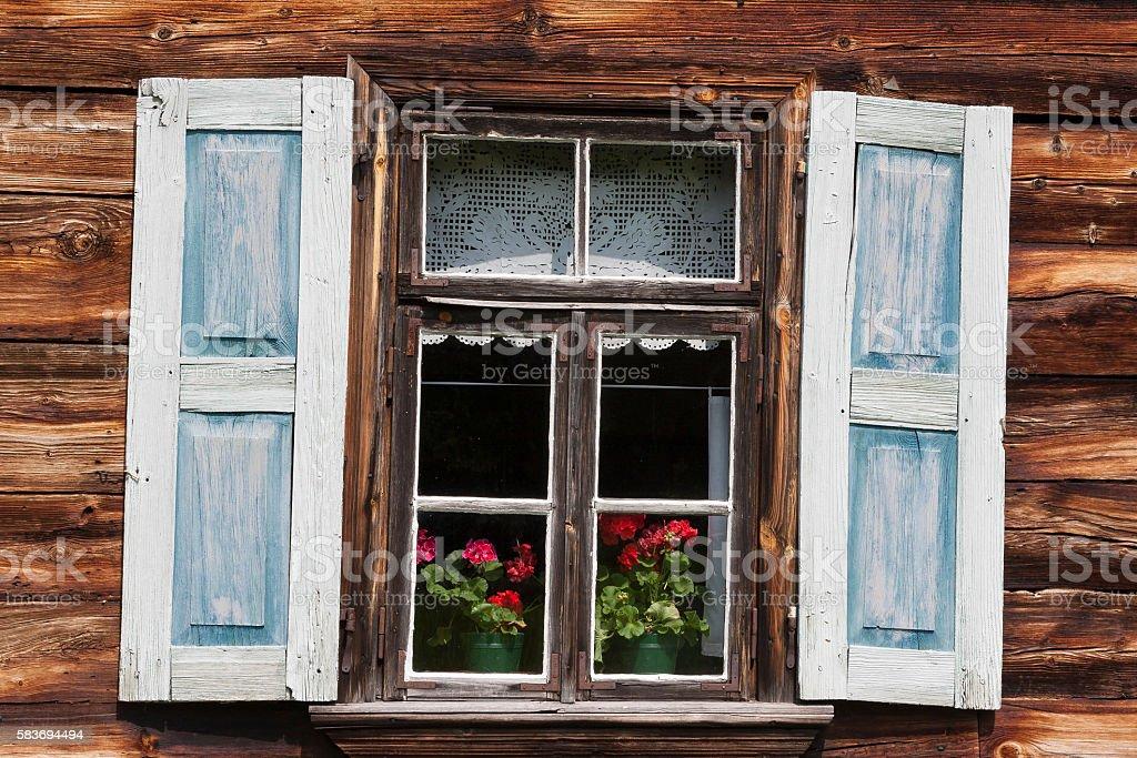 Windows on old wooden house stock photo