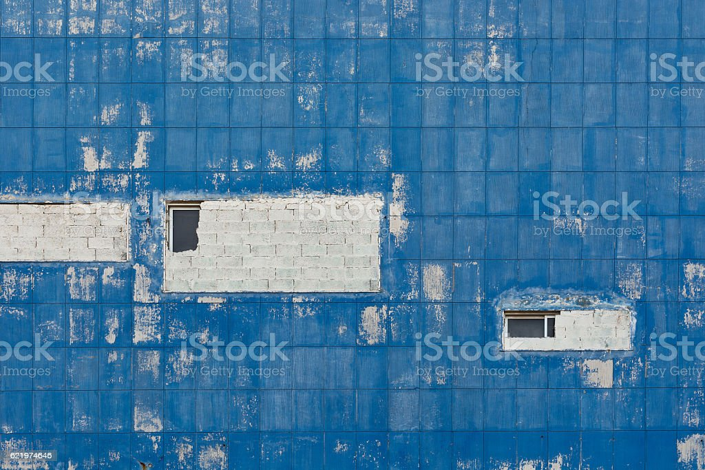 Windows on the Wall of an Old House stock photo