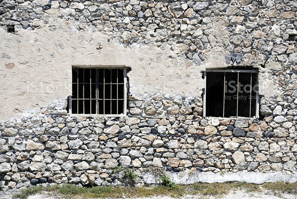 Windows with bars in old building, Greece royalty-free stock photo
