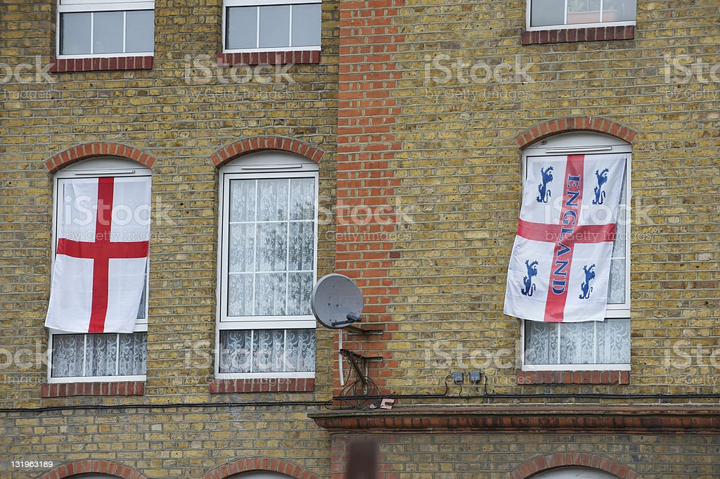 windows with two English cross flags stock photo