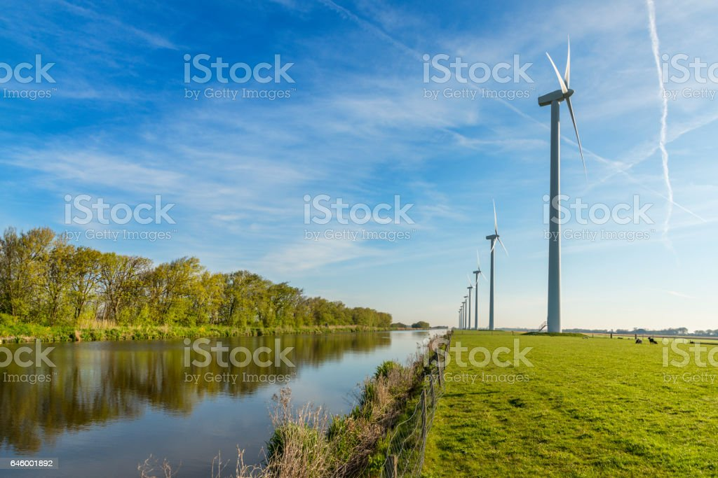 Windpark on dike, Holland stock photo