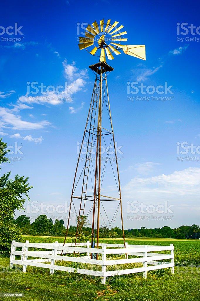 Wind-powered water pump on a farm near Goodells, MI stock photo