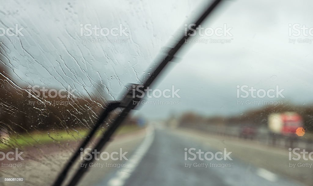 Windscreen wiper clearing road visibility stock photo
