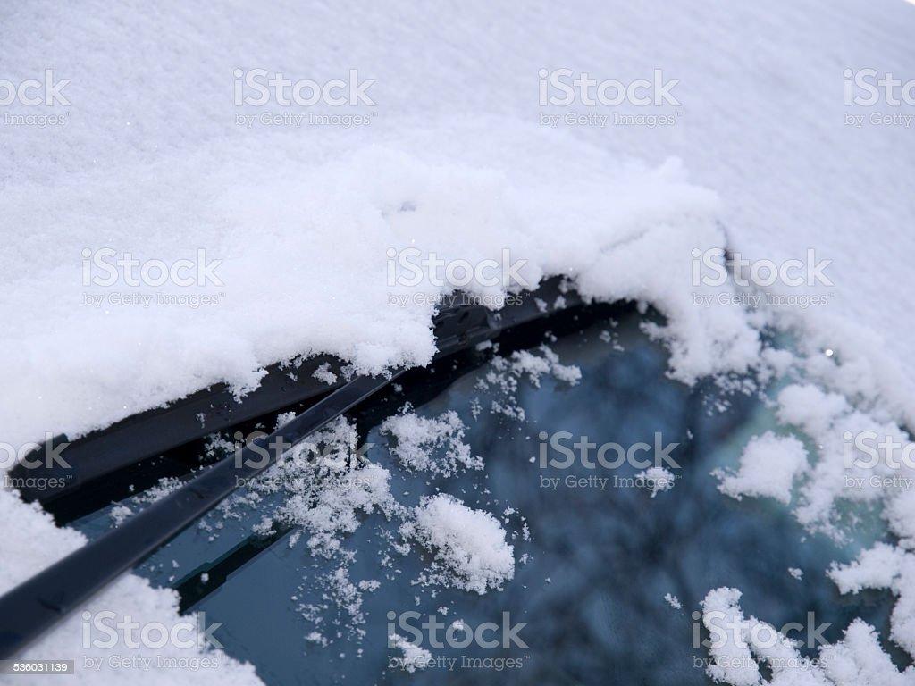 Windscreen wiper on snowy windsreen stock photo