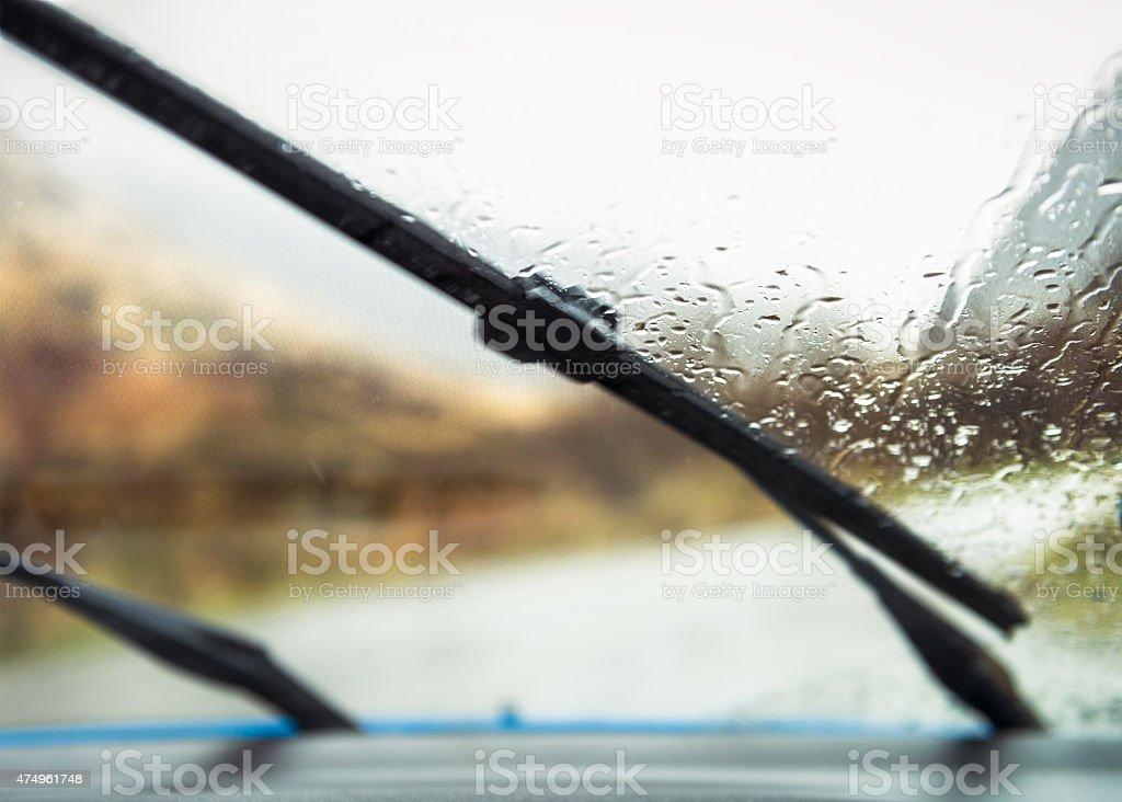 Windscreen wipers clearing rain stock photo