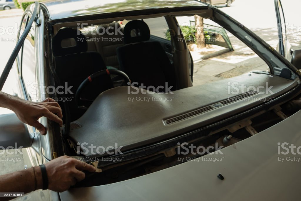 Repair and install auto glass,the broken windshield in car accident,