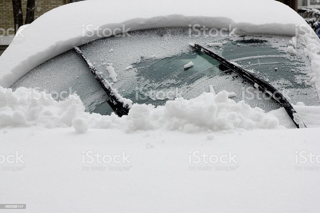 windshield wipers removes snow from windshield glass covered with snowdrift stock photo