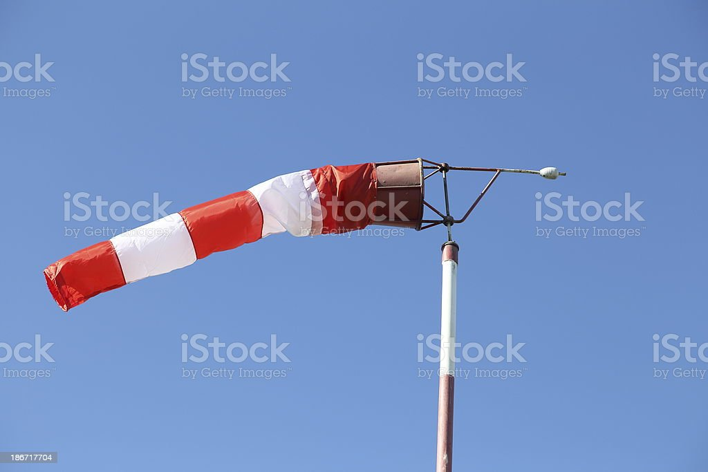 Windsock against blue sky stock photo