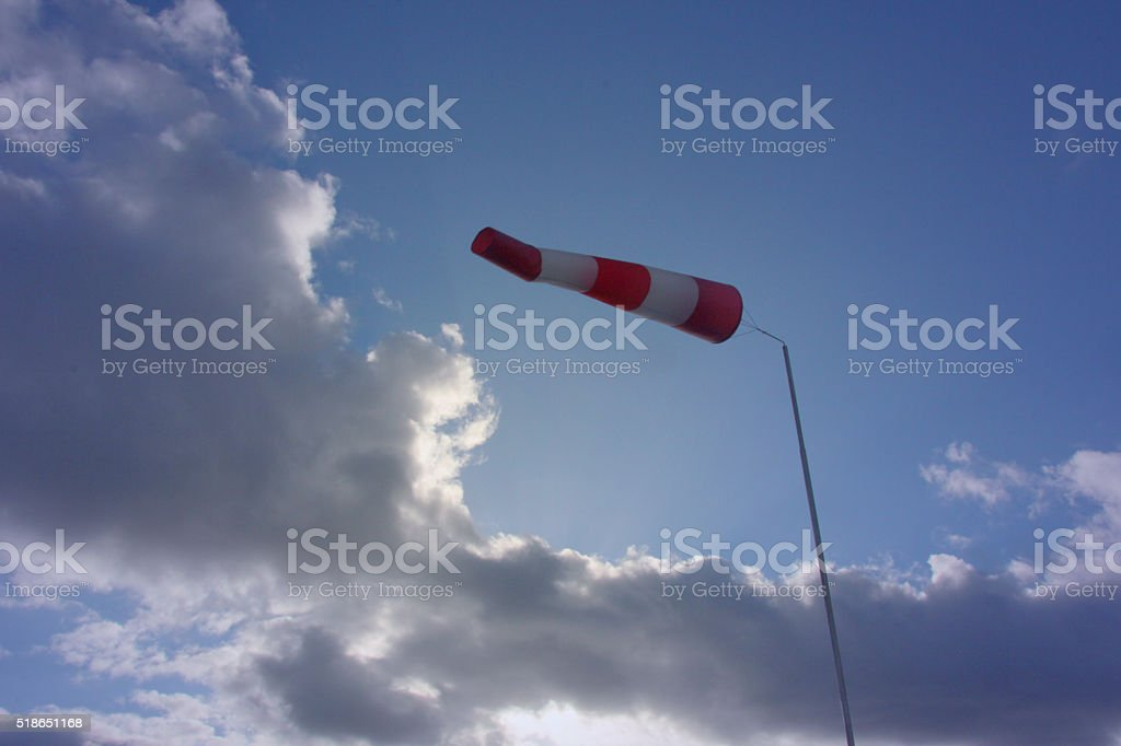 windsock and cloudy weather stock photo