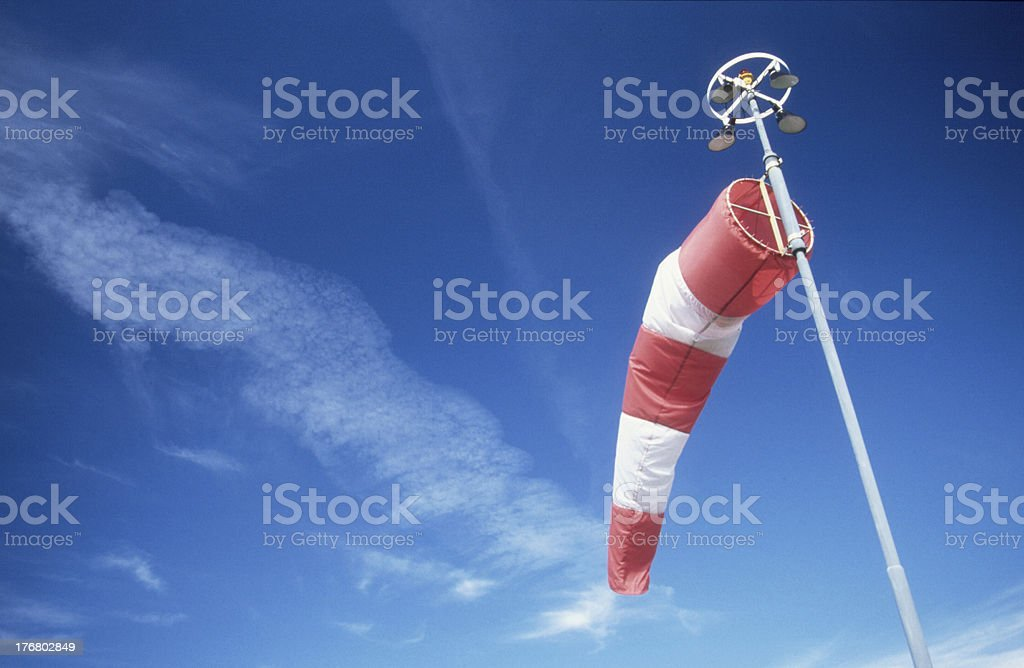 Windsock in front of the blue sky stock photo