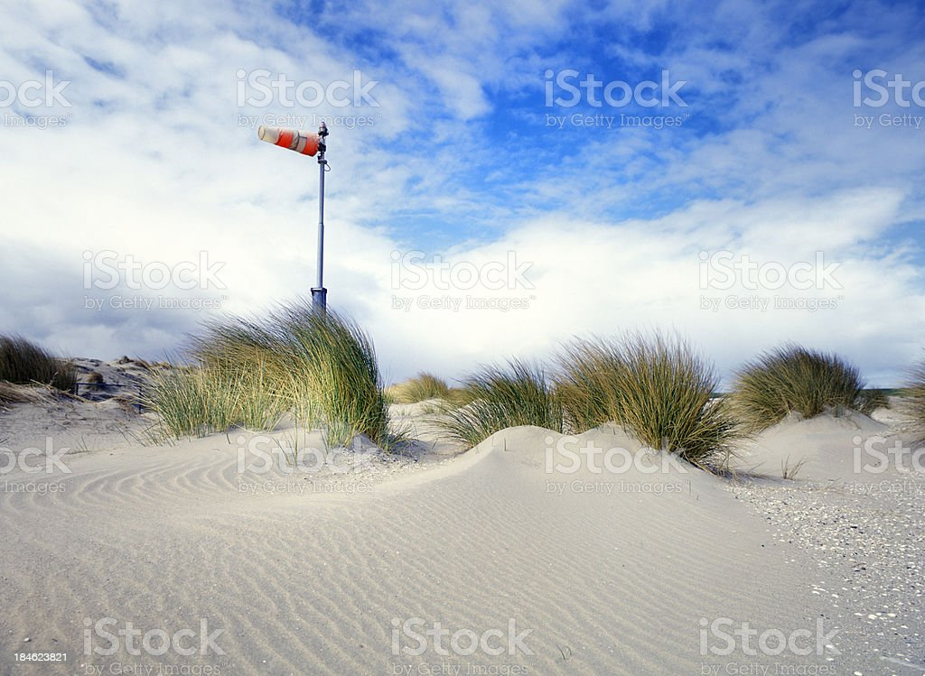 windsock in the dunes stock photo