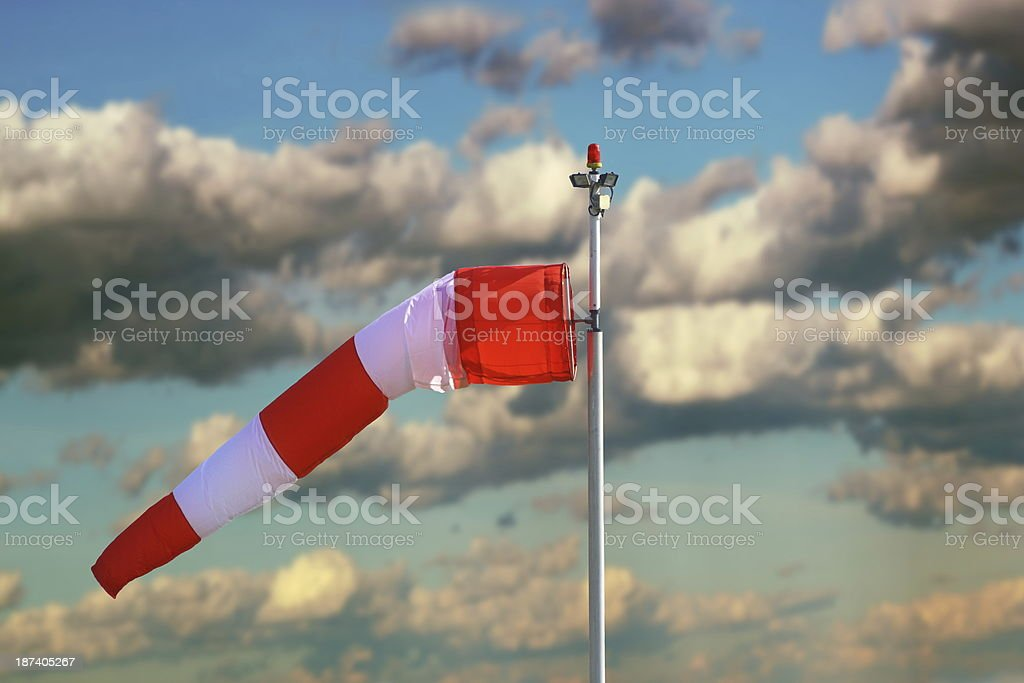 windsock over stormy sky stock photo