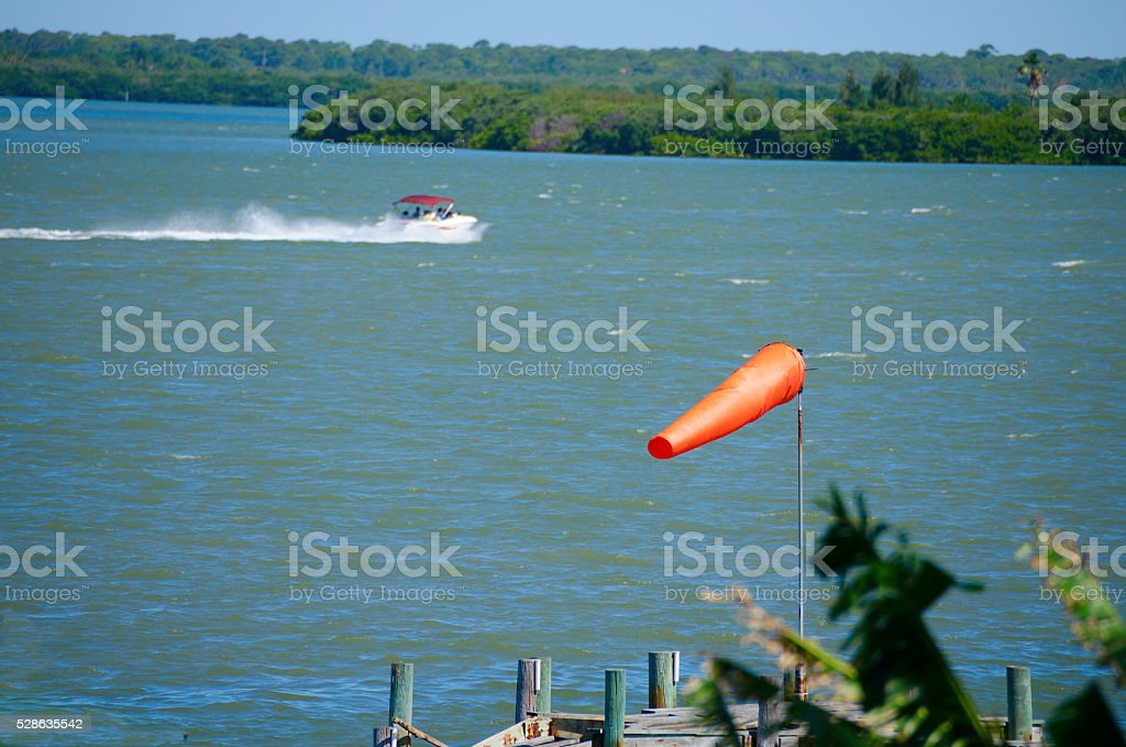 Windsock weather sock with wind and boat stock photo