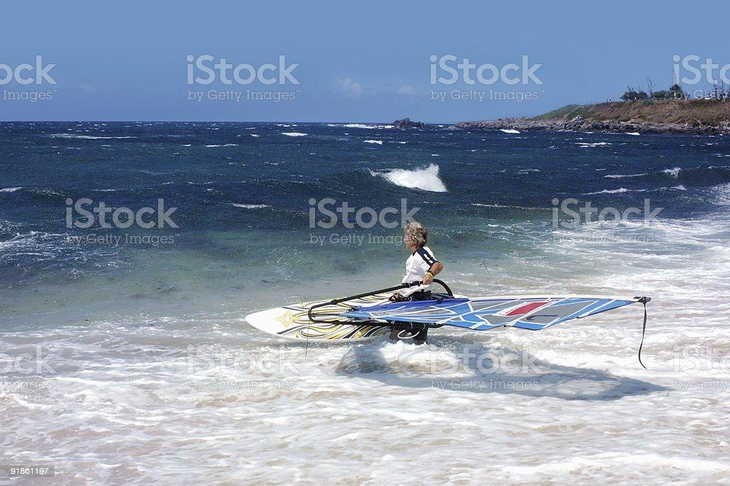 Windsurfer getting ready for windsurfing stock photo
