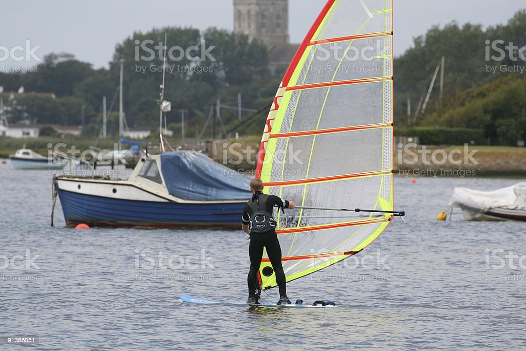 windsurfer in harbour stock photo