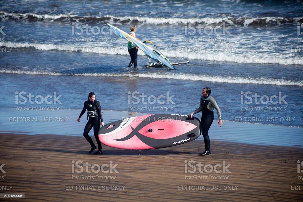 Windsurfers on the beach. stock photo