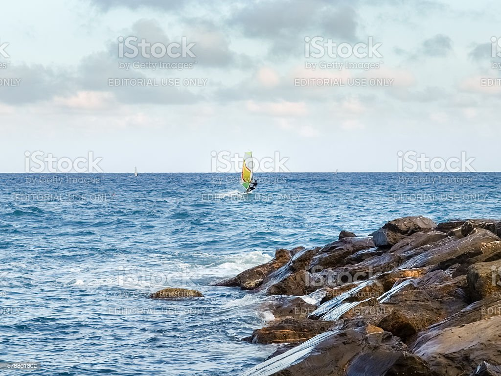 Windsurfing in the evening light stock photo