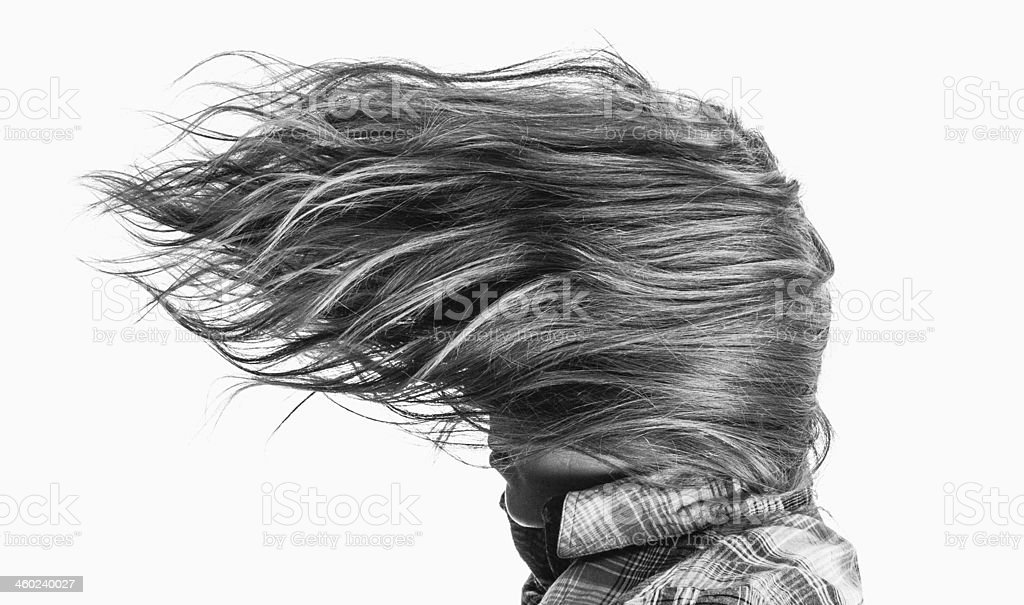 Windswept woman in check shirt stock photo