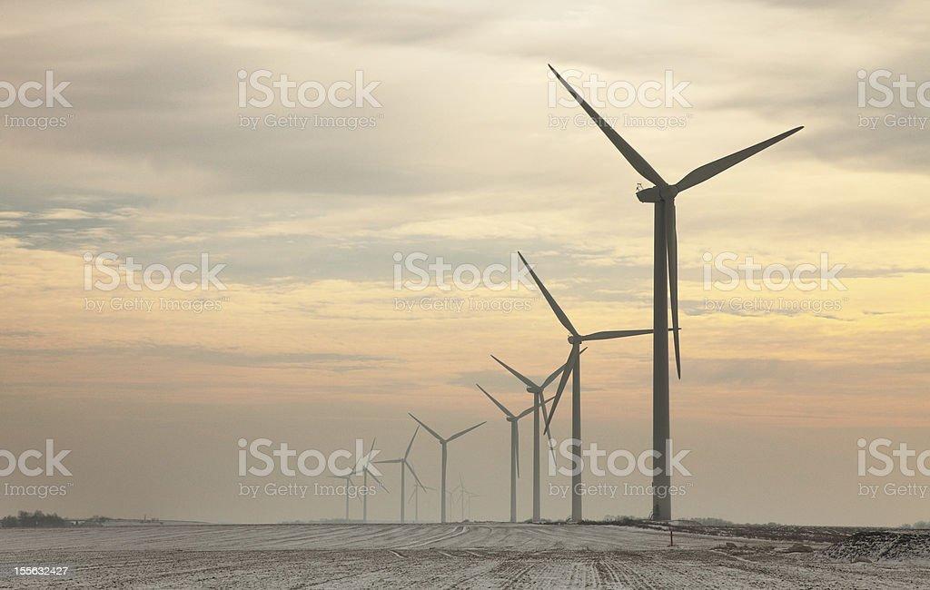 Windturbines at dusk stock photo