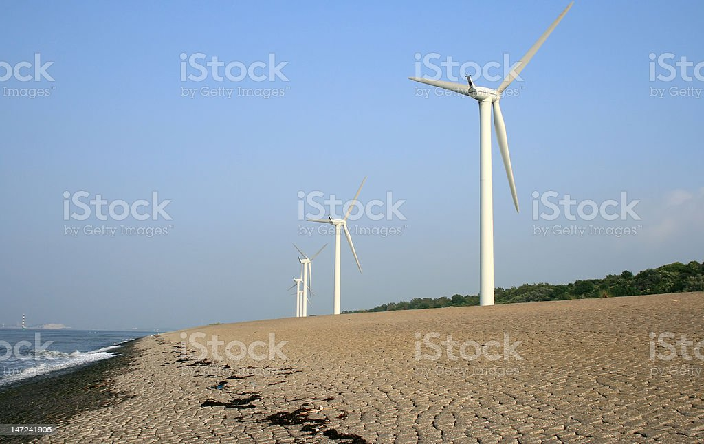 Windturbines by sea stock photo