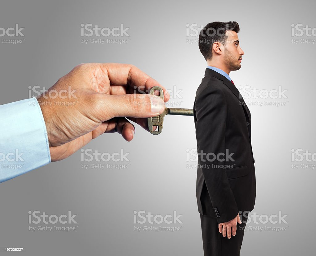 Wind-up businessman stock photo