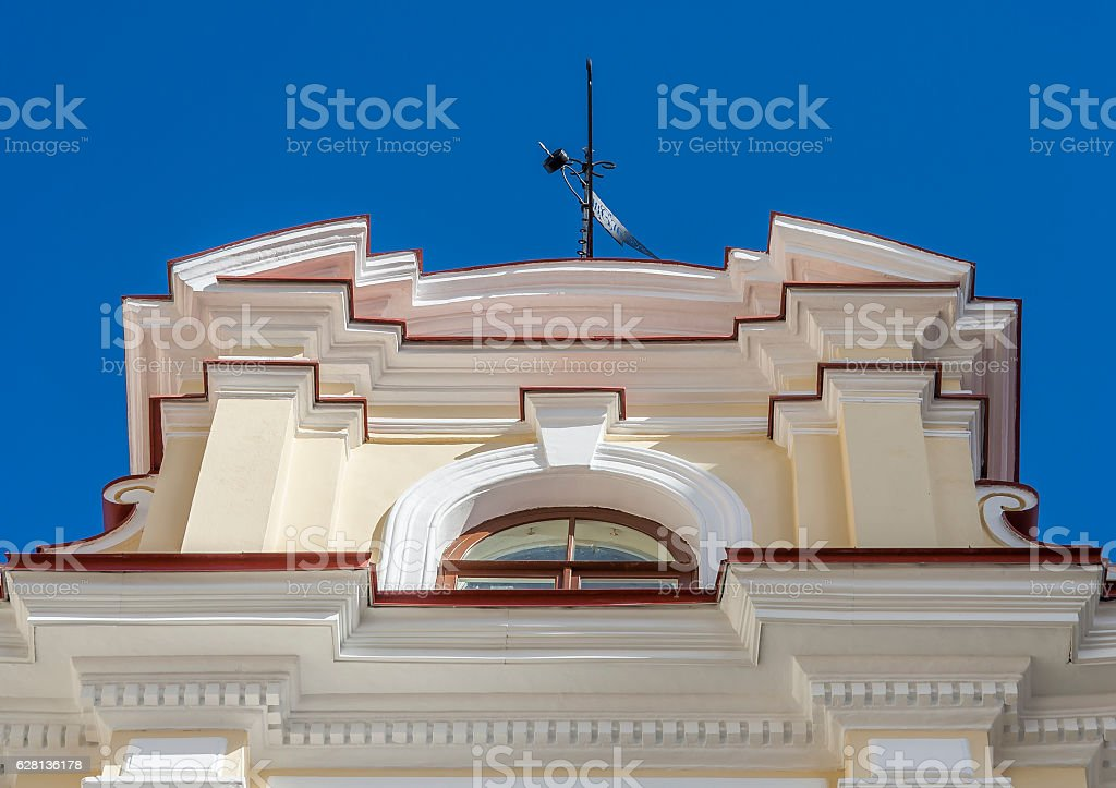 Wind-vane on roof top of medieval building stock photo