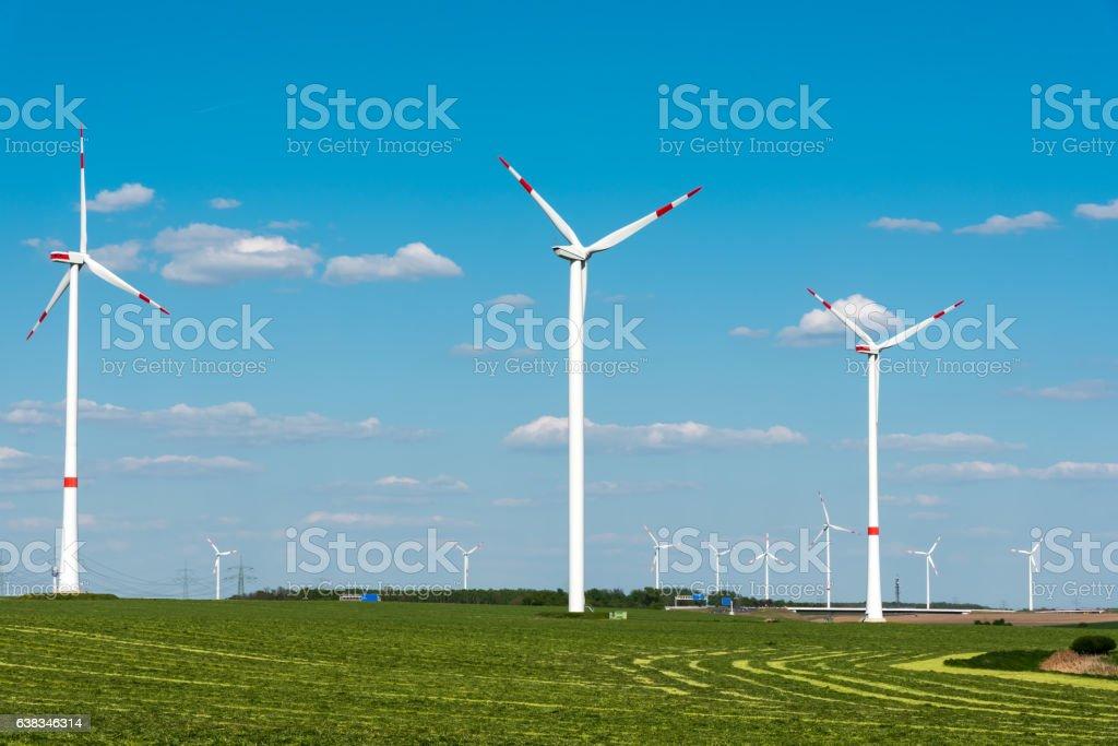 Windwheels in a grass field in Germany stock photo