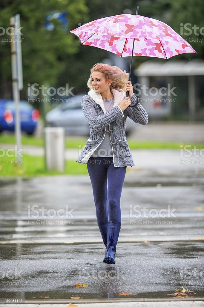 Windy and rainy day in the city royalty-free stock photo