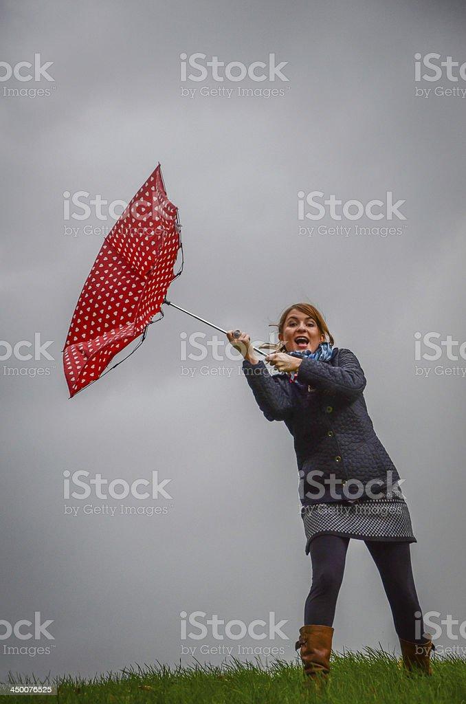 Windy day with umbrella stock photo