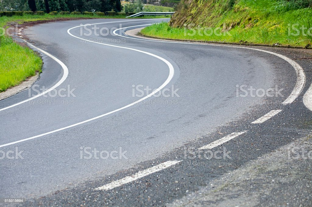 Windy mountainous country road. stock photo