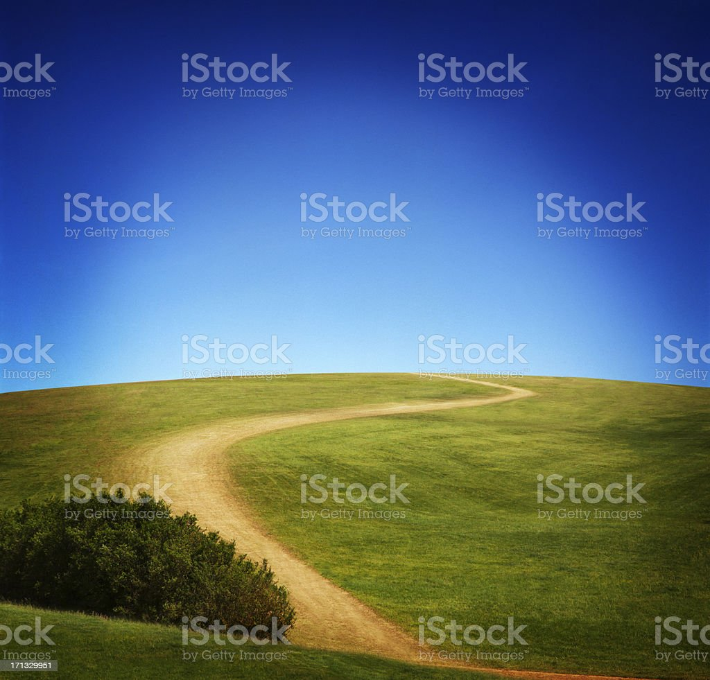 Windy Path Under Clear Sky stock photo