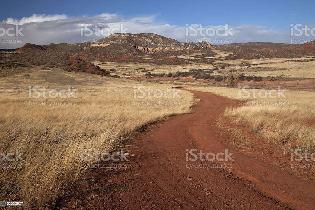 windy ranch road in mountain valley royalty-free stock photo