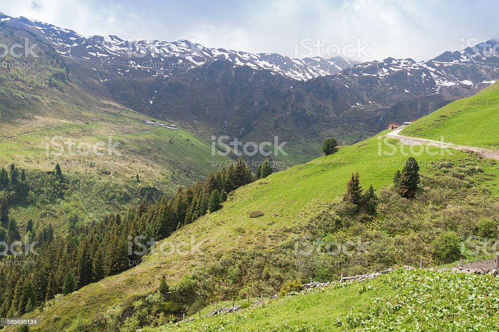 Windy roads at Zillertal valley surrounded by mountains with snow stock photo