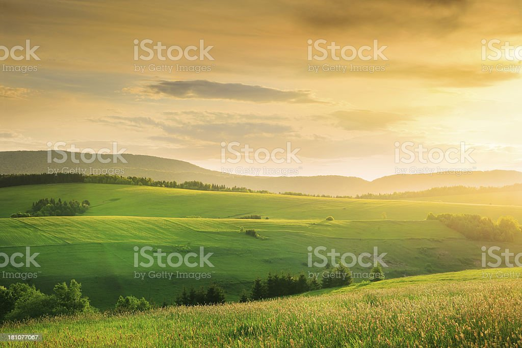 Windy Sunset over Fields and Meadows - Green Hills royalty-free stock photo