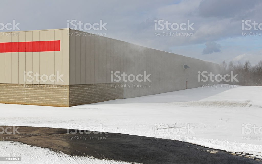 Windy Winter Snow Blowing Off Building stock photo