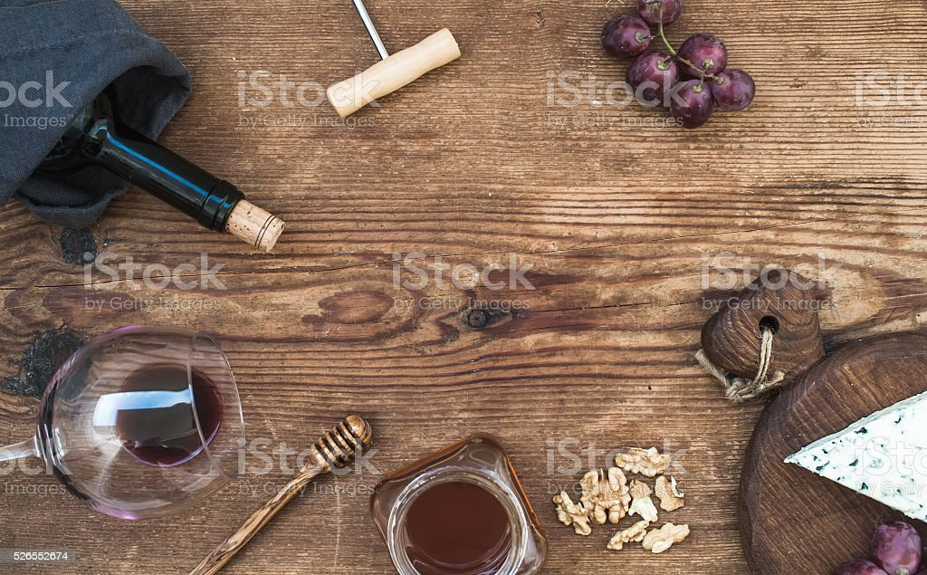 Wine and appetizer set with copy space in center. Glass stock photo