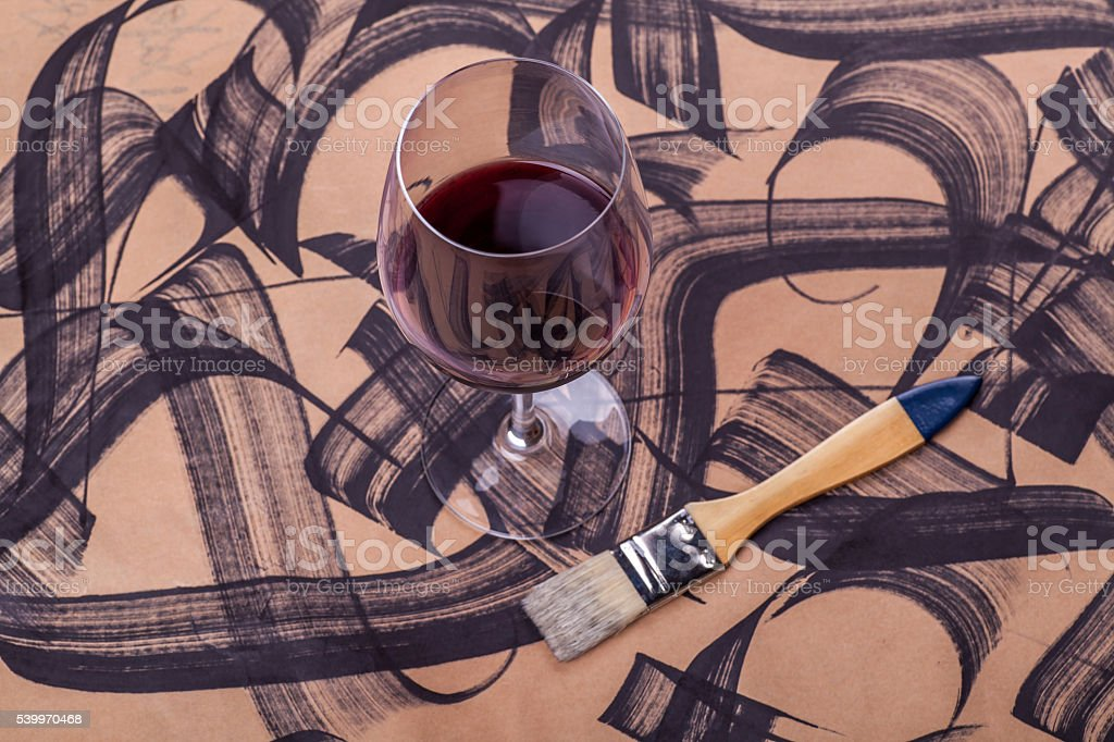 Wine and brush strokes stock photo