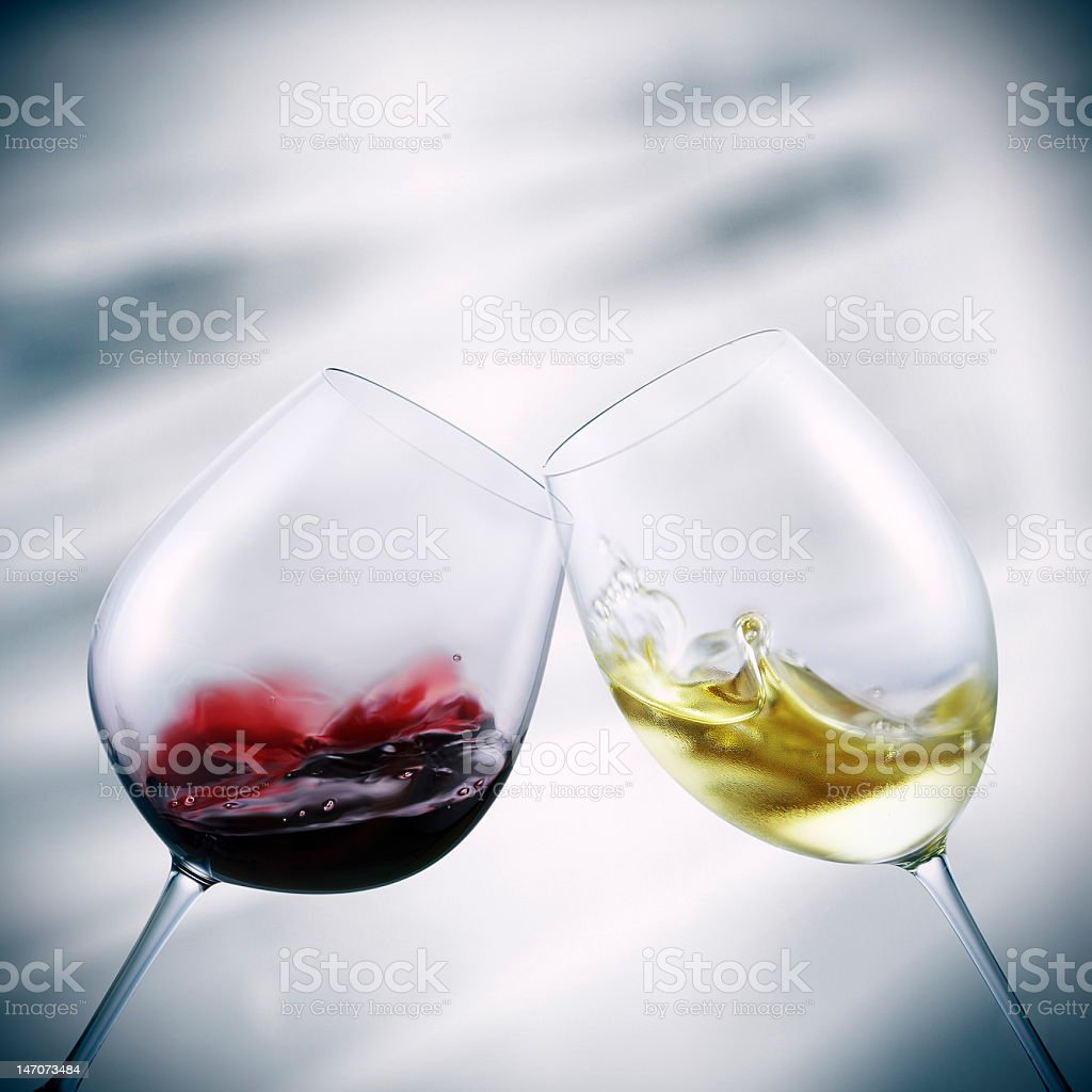 Wine and champagne glasses toasting royalty-free stock photo