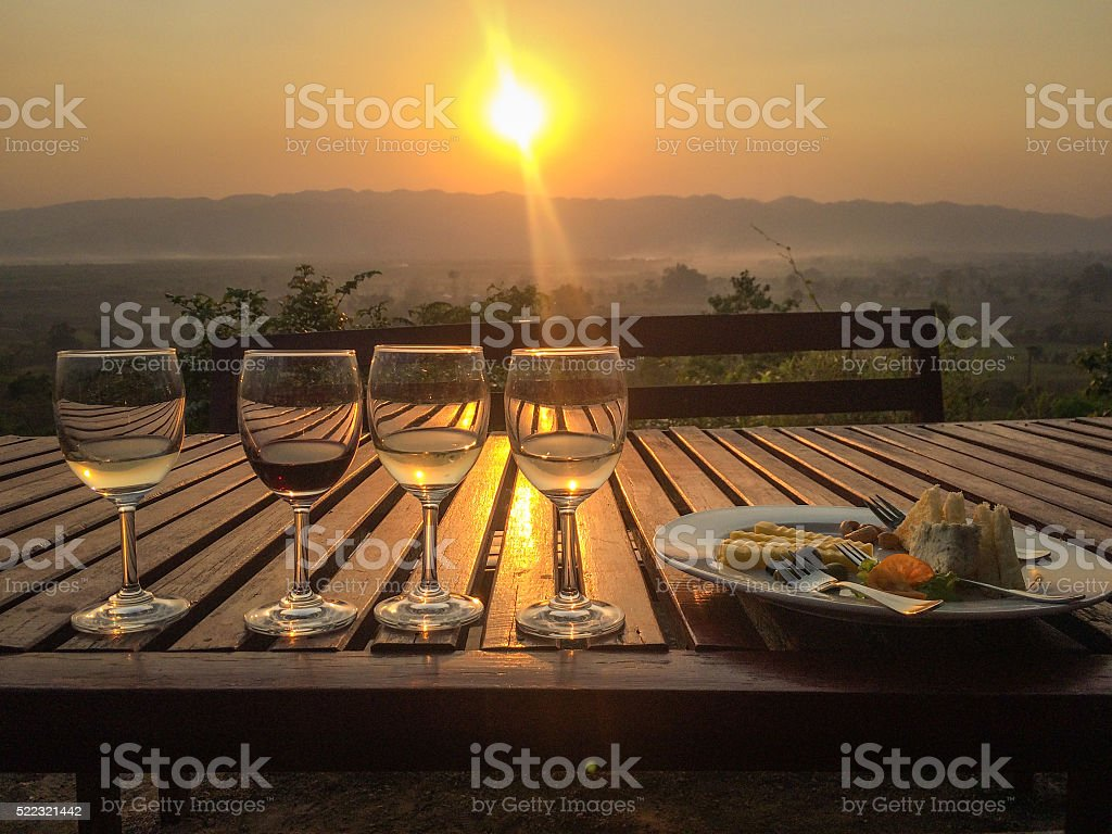 Wine and cheese at sunset stock photo