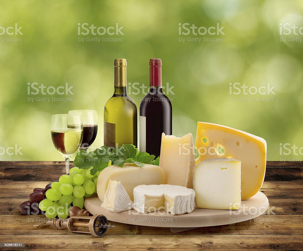 wine and cheese tasting in the countryside stock photo