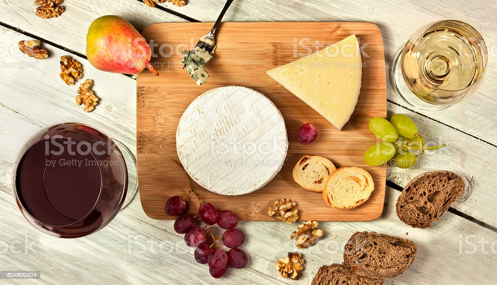 Wine and cheese tasting photo with fresh fruit stock photo