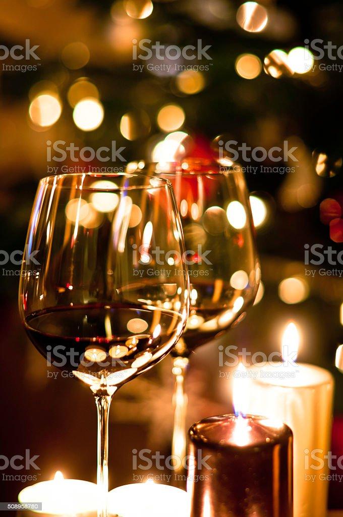 Wine and Christmas tree stock photo